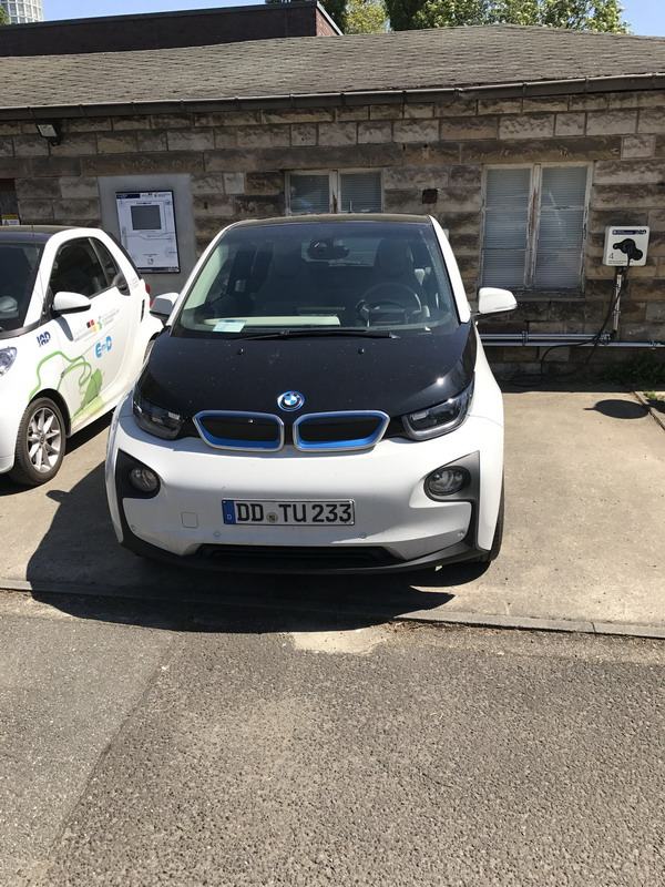 BMW I3 and Smart-Electric on the territory of the charging station in front of the faculty building